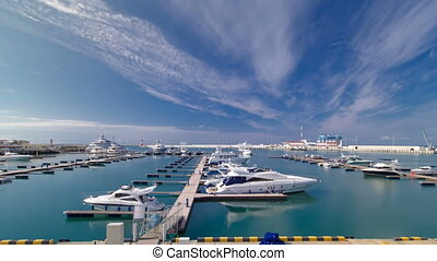 The city's waterfront, yacht in the sea port of Sochi...