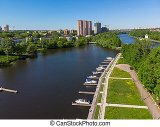The Cityscape of Khimki city and yacht parking on the river...