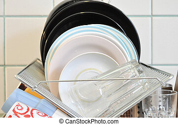 the clean dishes on the rack