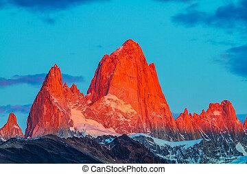 The cliffs Fitz Roy in crimson light of sunset - Sharp tops ...