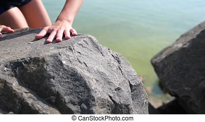 the climber climbs on the rocks. The achievement of height,...