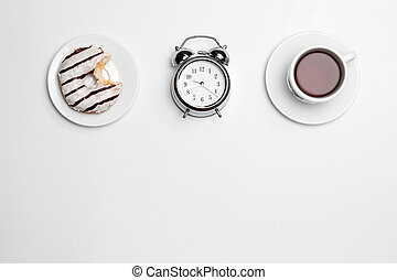 The clock, cup, cake on white background