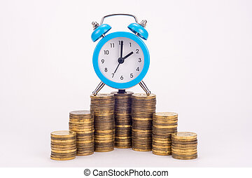 The clock is on a stack of coins
