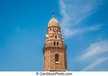 The clock tower of the Abbey of the Dormition building at mount zion in Jerusalem