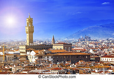 clock tower of the Old Palace (Palazzo Vecchio) in Signoria Square, Florence (Italy).