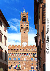 The clock tower of the Old Palace (Palazzo Vecchio) in Signoria Square, Florence (Italy).