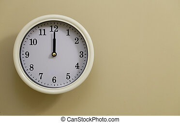 The clock's time is 12 o'clock