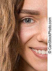 The close up eye on face of young beautiful caucasian girl