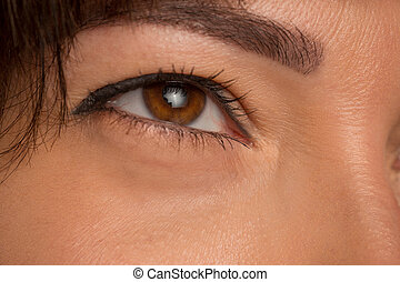 The close up eyes on face of young beautiful caucasian girl