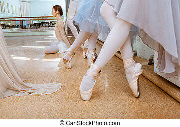 The close-up feet of young ballerinas in pointe shoes