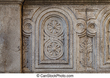 The close up of stone sculptures detail on the outer wall