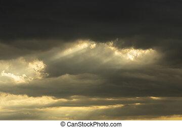 The cloud in rain season with sunlight.