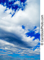 The clouds on background blue sky.