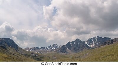 The clouds over the peaks of Kyrgyzstan. Time Lapse. UltraHD...