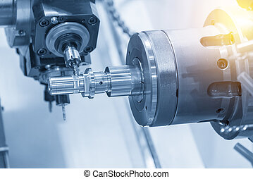 The CNC lathe machine milling the steel shaft by milling...