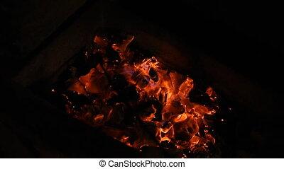 The coals in the grill. - The coals in the grill nice...