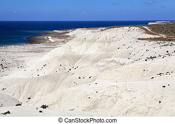 The coat view from the hill on the beach after Punta Loma near Puerto Madryn, a city in Chubut Province In Patagonia, Argentina. Puerto Madryn is protected by the Golfo Nuevo, which is formed by the Peninsula Valdes and the Punta Ninfas