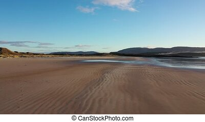 The coast between Kiltoorish bay beach and the Sheskinmore bay between Ardara and Portnoo in Donegal - Ireland.