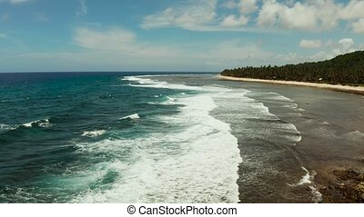 The coast of Siargao island, blue ocean and waves. - Waves...