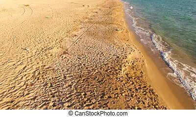 The coastal sand line is trampled. bird's eye view. - The...