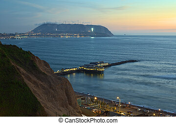 The coastline of Lima, Peru at twilight with the Restaurant...