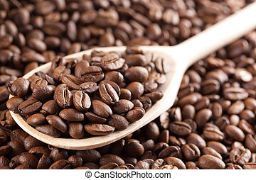 coffee beans on wooden spoon