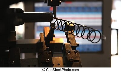 The coil spring manufacturing machine