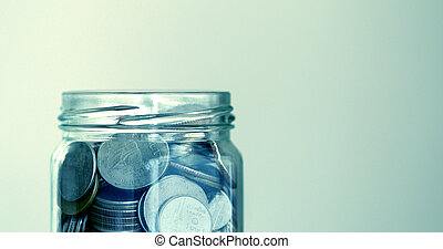 The Coins in glass jar for money saving financial concept