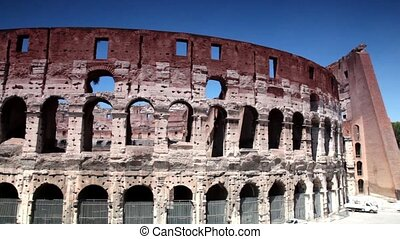 The Coliseum facade shown in motion, then shows some area...