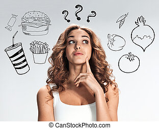 The collage of young beautiful woman with healthy and harmful meal. Detox diet and vegetarianism