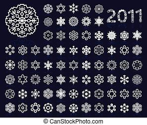 The collection of icons of snowflakes of dark blue colour. A...