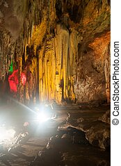 The colorful limestone formations at Khao Bin Cave in...