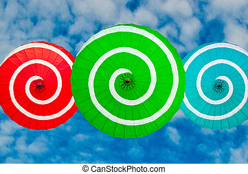 The Colorful of umbrella isolated on blue sky background