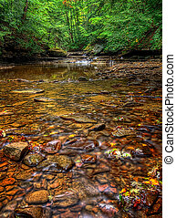 Brandywine Creek - The colorful rocks in the clear water of...