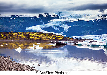 The colossal glacier Vatnajokull is melting at the edges,...