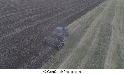 The combine removes the mote that has remained after mowing....