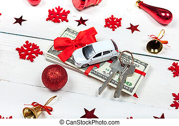 A car with keys and a stack of banknotes