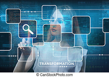 The concept of business, technology, the Internet and the network. A young entrepreneur working on a virtual screen of the future and sees the inscription: Transformation