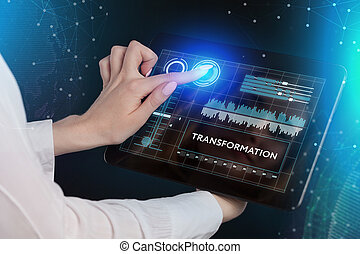 The concept of business, technology, the Internet and the network. A young entrepreneur working on a virtual screen of the future and sees the inscription: Transformation.