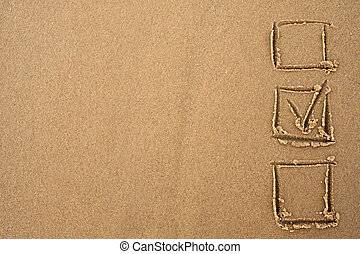 The concept of choice. A tick in the questionnaire drawn on the sand. Decision making while traveling.