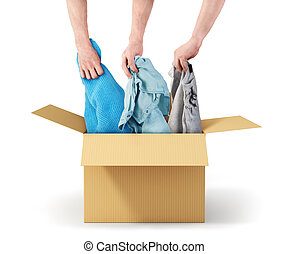The concept of donation. Hands take out clothes from a cardboard box on a white background.