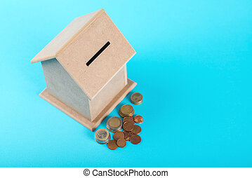 The concept of financial savings to buy a house. Money box...