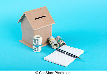 The concept of financial savings to buy a house. Money box,...