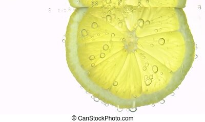 The concept of freshness, a slice of lemon in clear water, ...