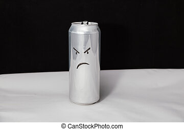 The concept of grumpy man. Angry emoticon on aluminium can, Emoji with rageful face. On black background