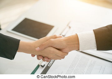 The concept of handshake is a visual business partner. The second handshaking process is a handshaking of successful management.
