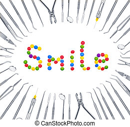 The concept of harm to the teeth. The smile of sweets around dental tools.