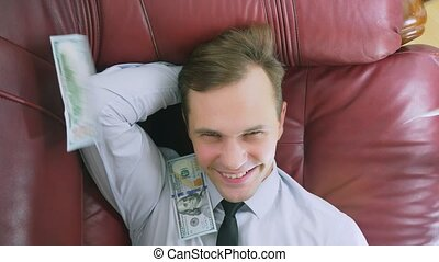 the concept of passive income. a happy person is lying on...