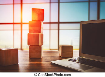 Wooden cubes and computer - The concept of planning in...