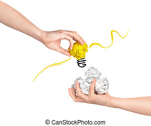 The concept of selecting the best ideas. Hand takes a crumpled piece of paper on an isolated white background.